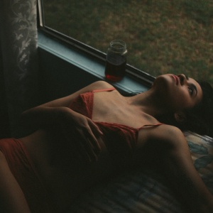 woman laying in orange bra