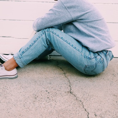 woman in jeans sitting