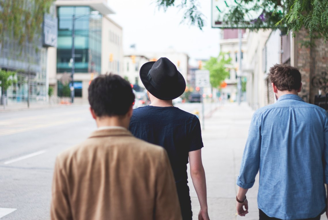 Men walking down the street together