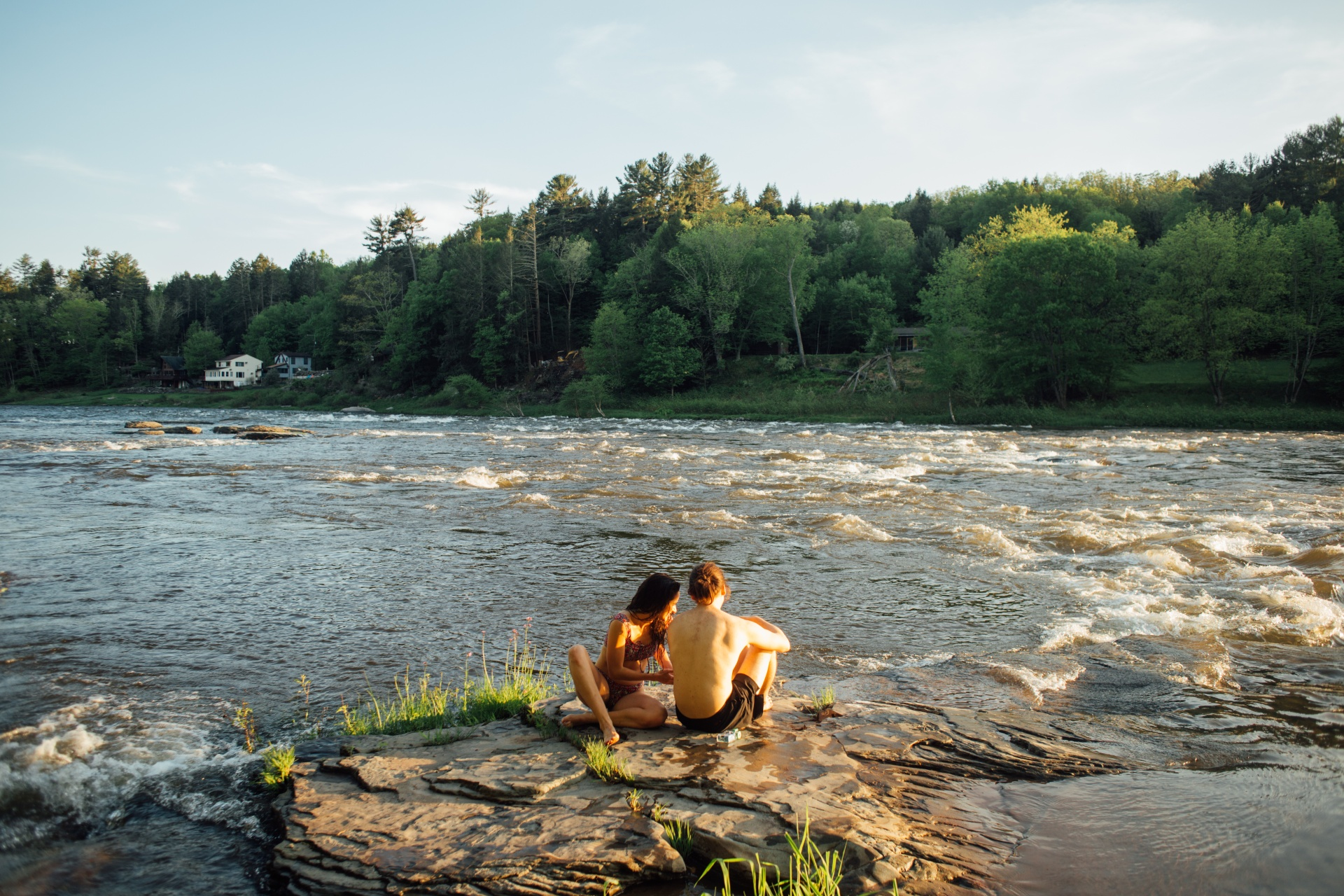 couple having fun by river