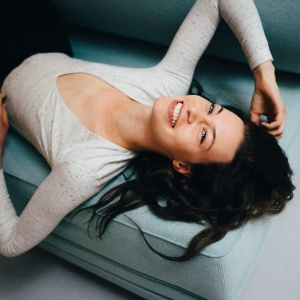 woman laying down on couch