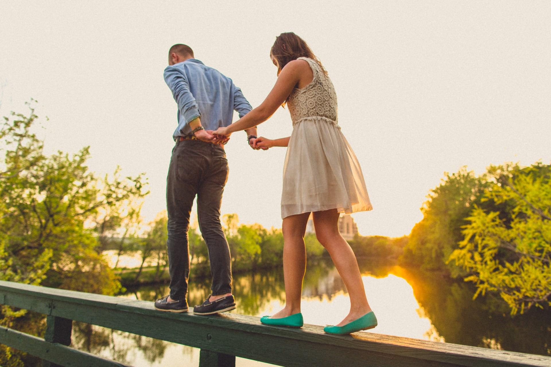 couple walking on ledge