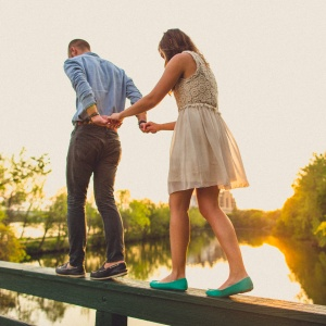 couple walking on ledge