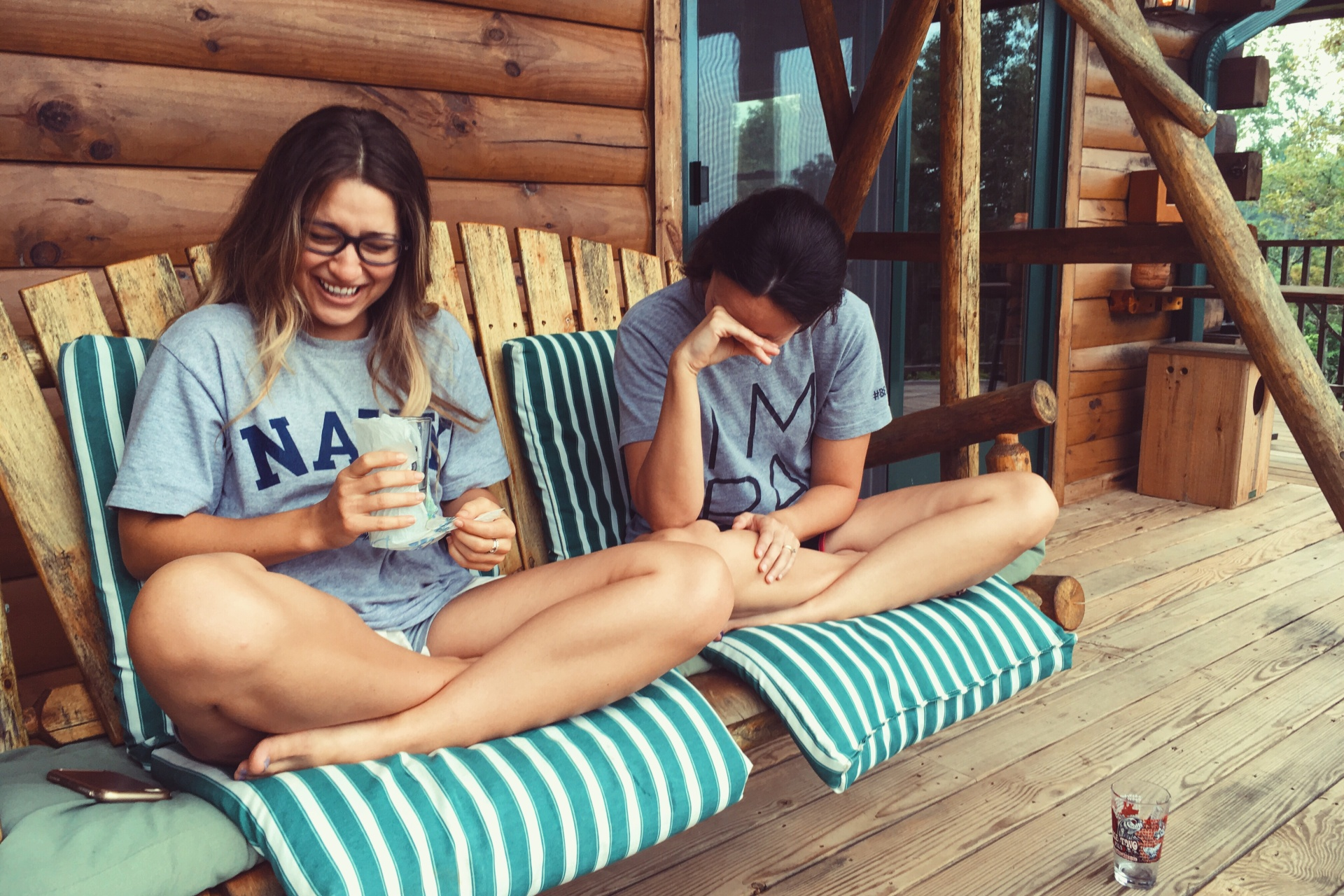 sisters laughing on porch