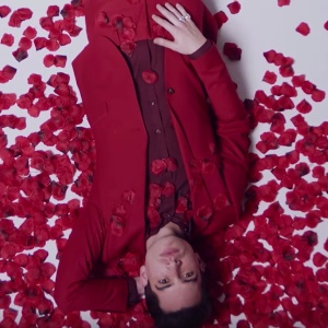 Brendan Urie surrounded by rose petals