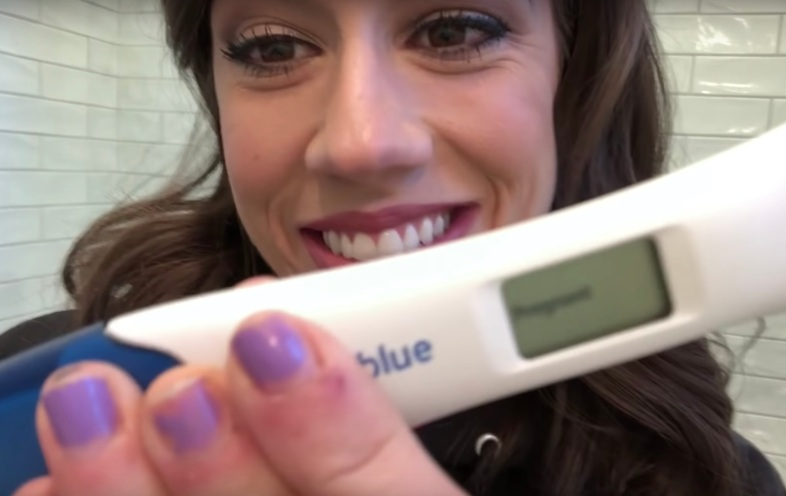 Colleen Ballinger with her pregnancy test