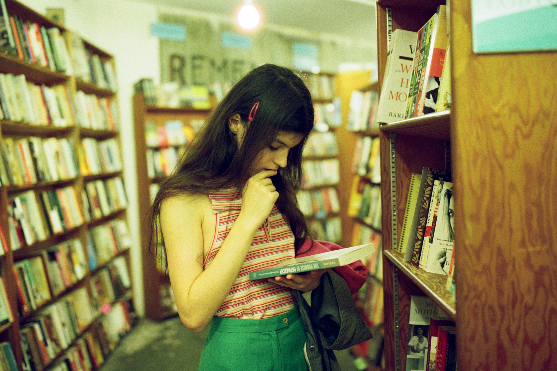 woman looking at a book