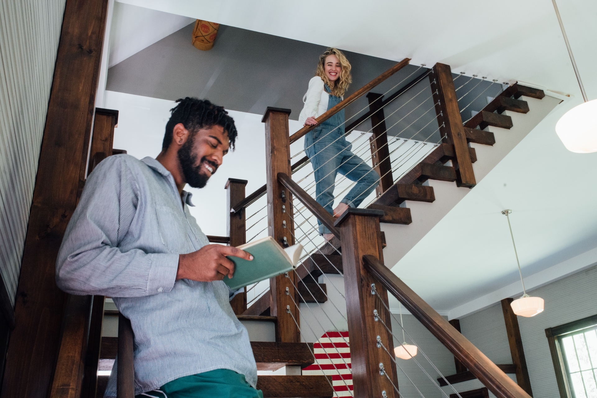 cute couple hanging out on stairs