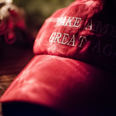 White Hoods Are Making A Comeback In The Form Of Red Hats
