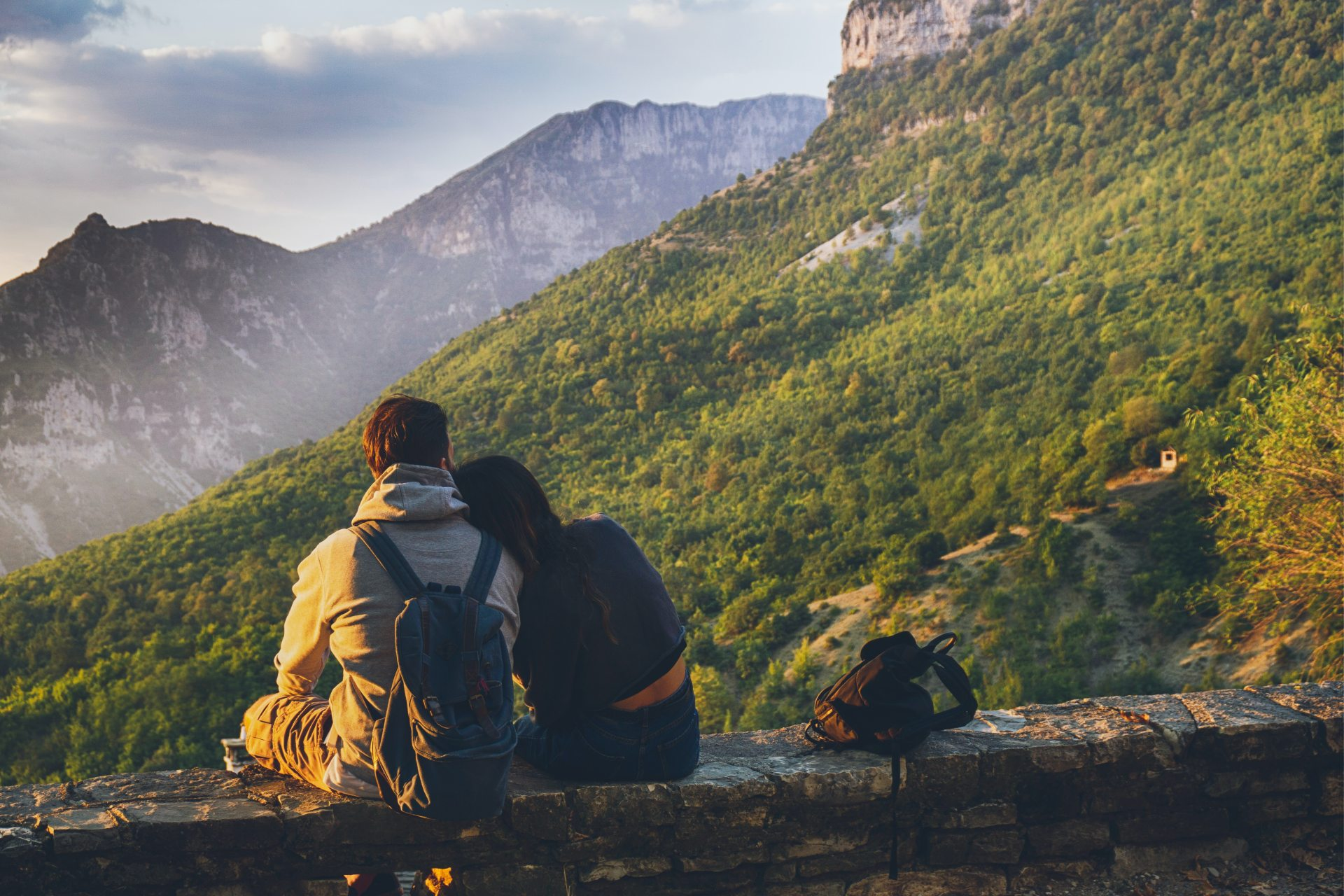 Couples Sitting in While Facing Mountain