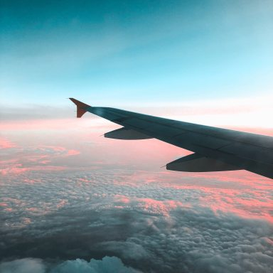 View of Airliner Wing Above the Clouds