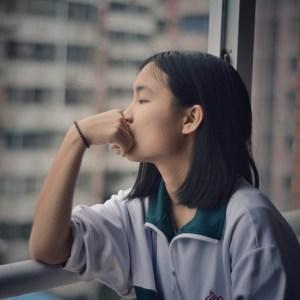 Teenage Girl Window Railing