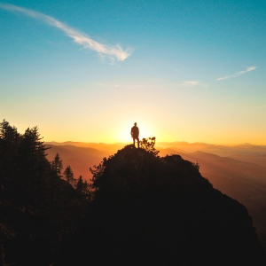 silhouette of man standing on mountain