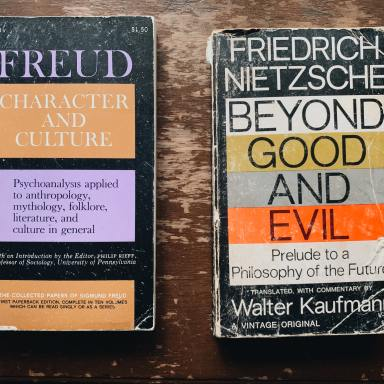 Two novel books on wooden surface