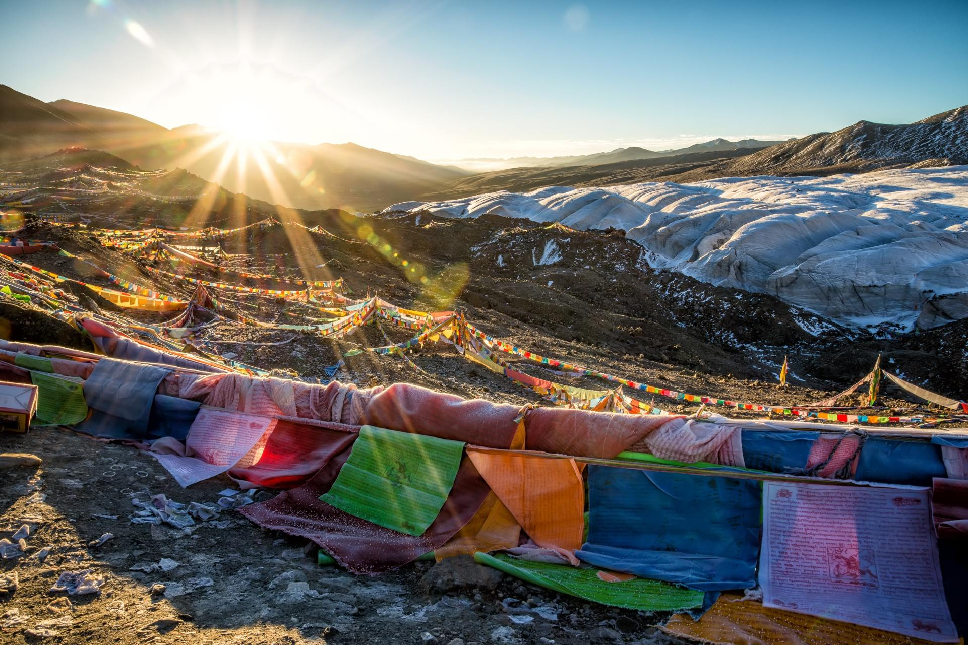 multicolored lines on hill under clear sky during sunrise photo
