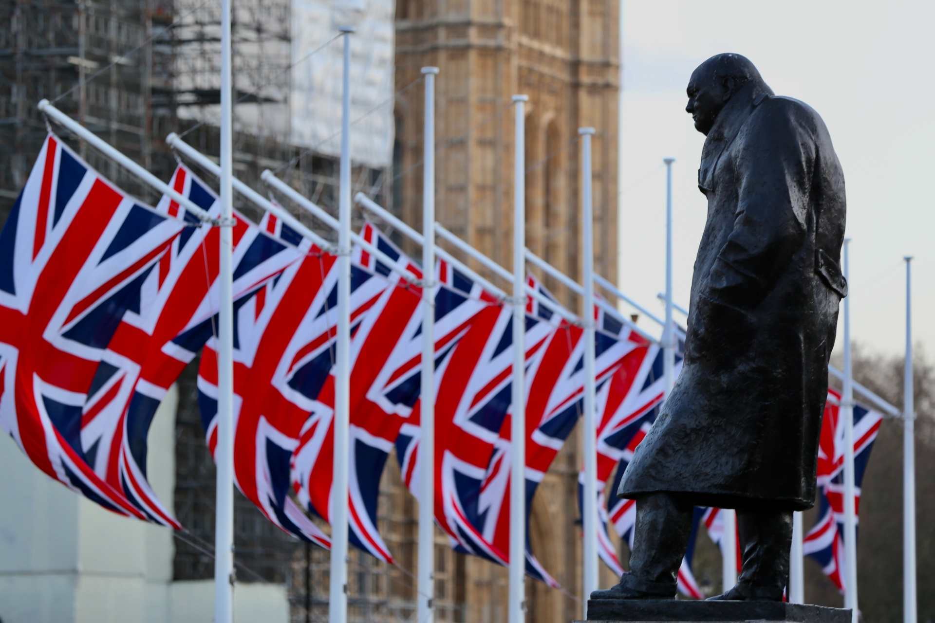 Winston Churchill near the English flag