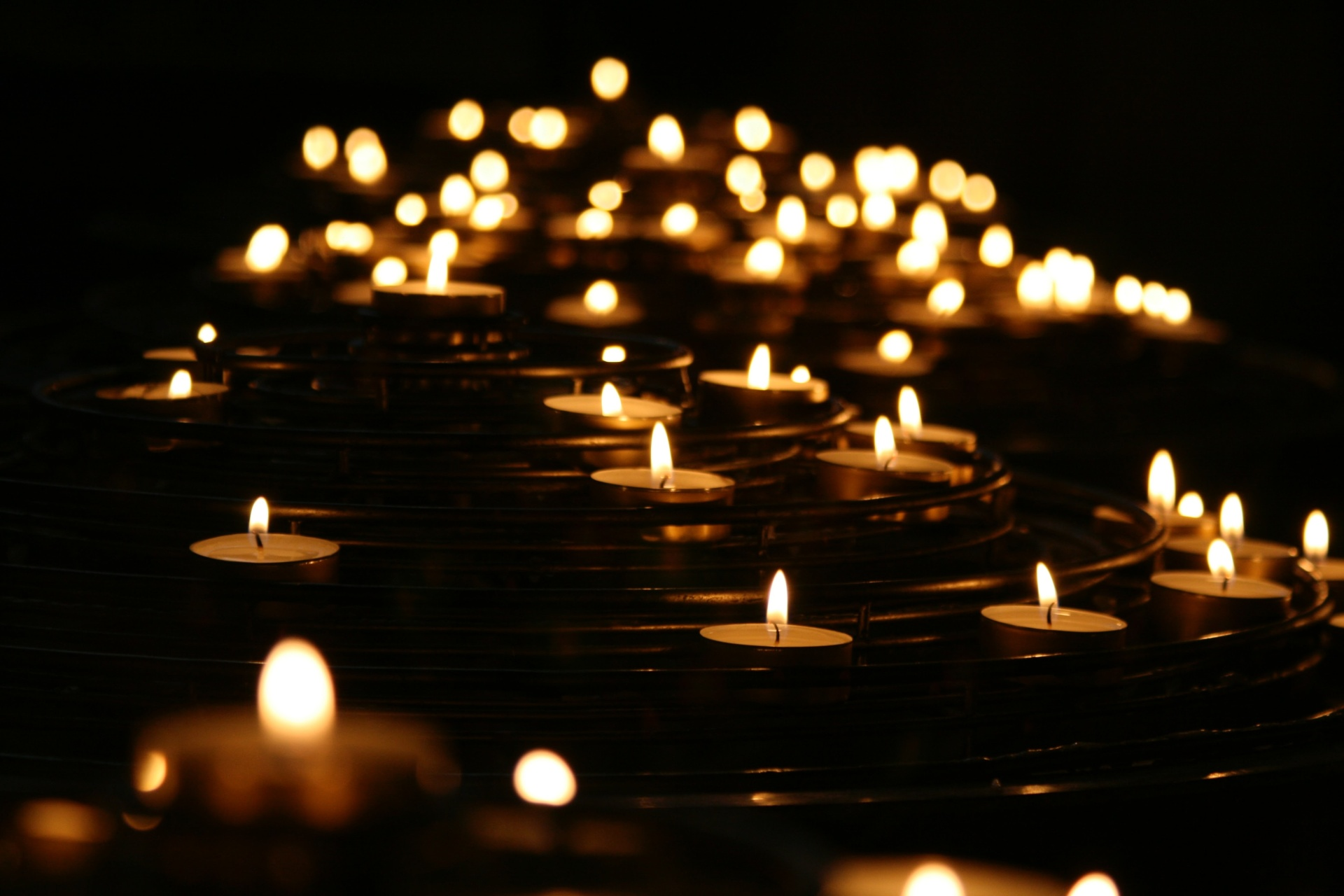 low-angled photo of lightened candles