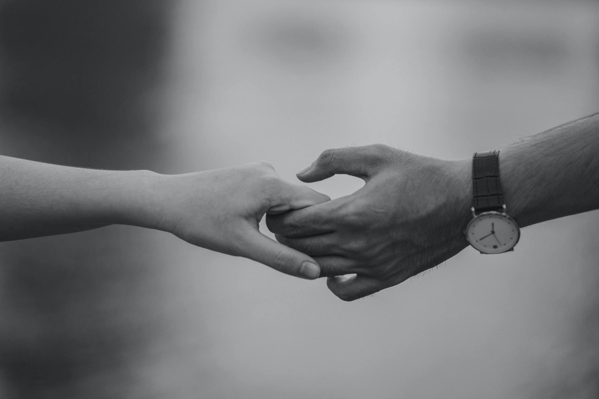 Monochrome Photo pf Couple Holding Hands