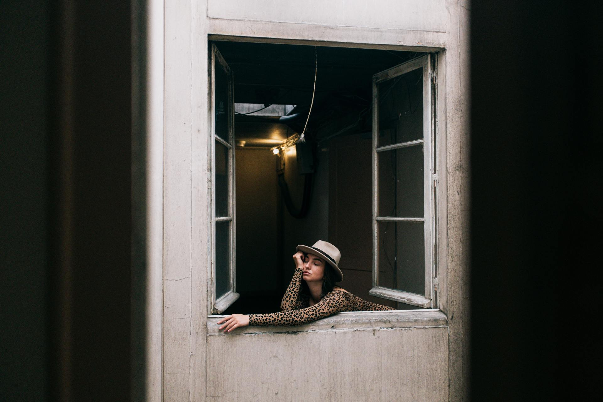 Photo Of Woman Leaning On Window